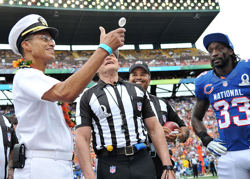 Adm. Haney flips the coin at the Pro Bowl.