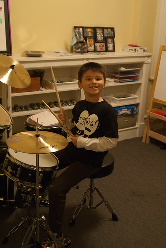 the kid is pleased with his new drums