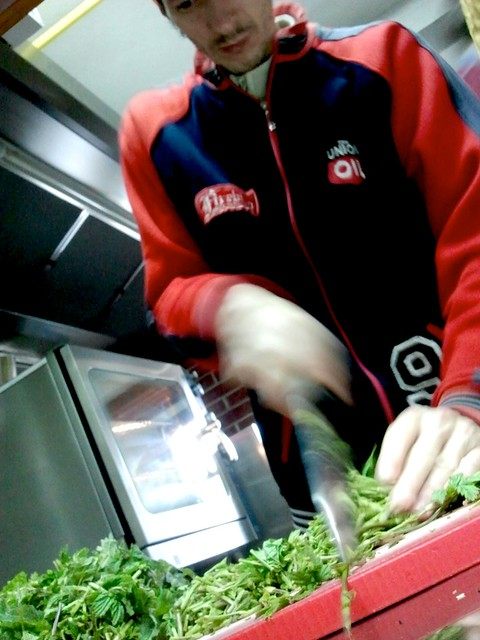 chopping plants in Majerija's kitchen