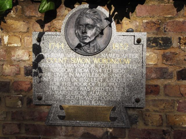 Simon Worcnzow stone plaque - 1744 1832 This road was named after Count Simon Worcnzow Russian Ambassador to the United Kingdom from 1784 to 1806 He lived in Marylebone and on his death in 1832 left a bequest for the poor of the parish The money was used to build St Marylebone Almshouses at the south-west corner of this road