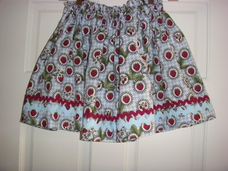 Strawberry print skirt with rick rack