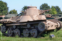 armored car(0.0), army(0.0), churchill tank(0.0), combat vehicle(1.0), military vehicle(1.0), weapon(1.0), vehicle(1.0), tank(1.0), self-propelled artillery(1.0), gun turret(1.0), cannon(1.0), land vehicle(1.0), military(1.0),