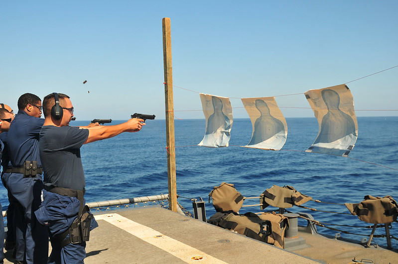 Sailors practice firing 9mm pistols