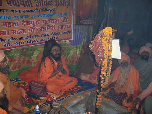 Sadhu with his devotees at the Kumbh Mela offering thanks