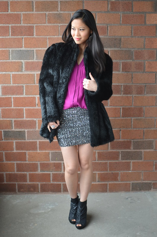 black oversized faux fur coat, mini sequin skirt, black booties