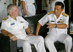 Rear Adm. Tom Carney, left, and First Adm. Dato Seri Pahlawan Haji Abdul Halim converse after the opening ceremony Nov. 5 for the 18th annual Cooperation Afloat Readiness and Training (CARAT) exercise between the U.S. Navy and Royal Brunei Armed Forces. (U.S. Navy photo by Chief Mass Communication Specialist Michael Ard)