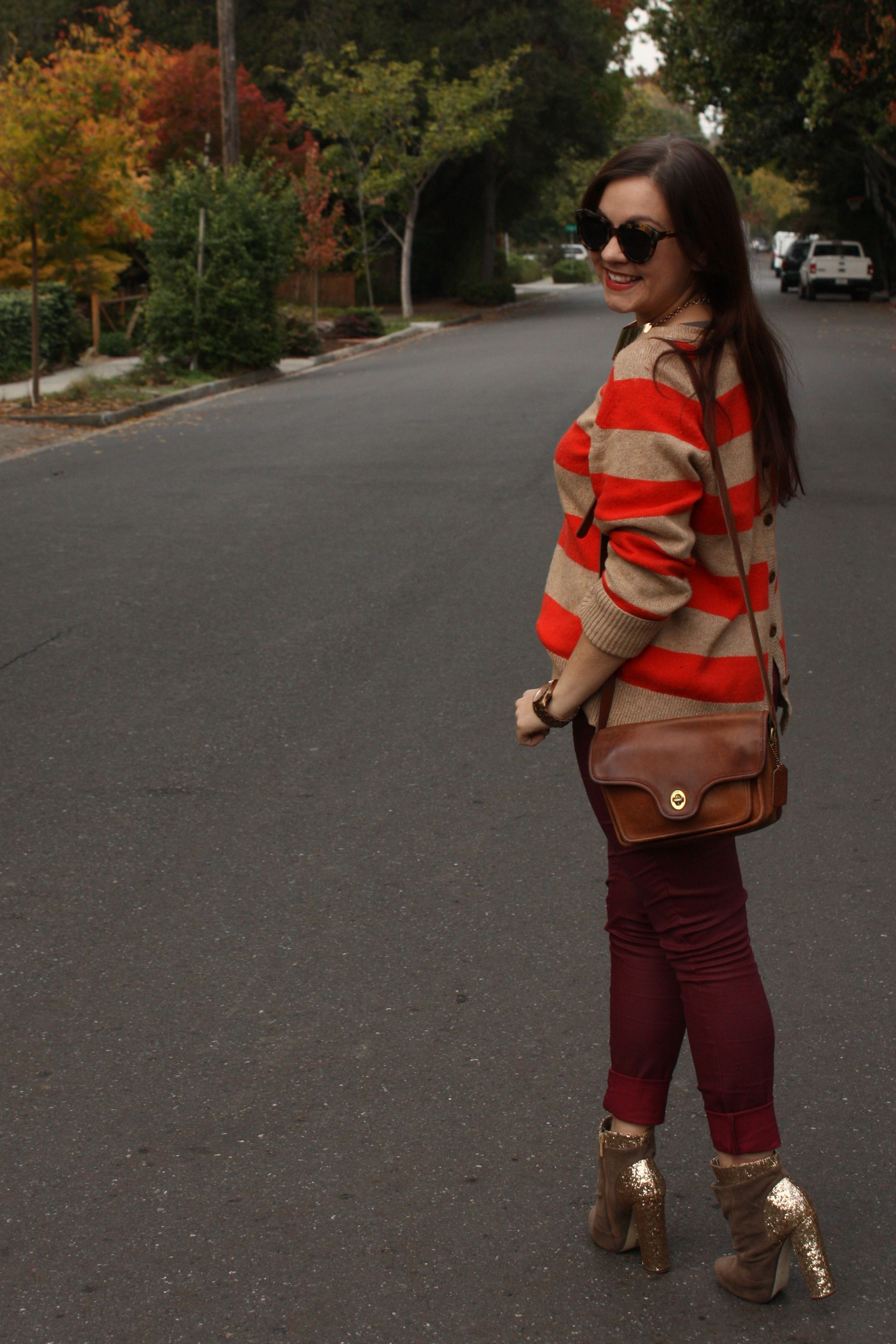 burgundy waxed jeans with orange striped lands end sweater and brown coach bag plus glitter booties06