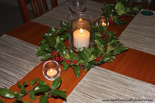 Holiday tablescape with a holly wreath