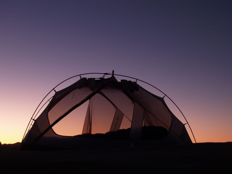 Dawn Silhouette of our tent at the Wind Caves