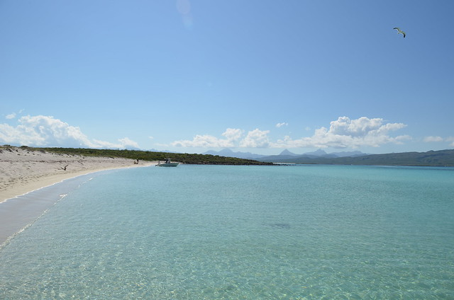 the clear water of the secluded beach