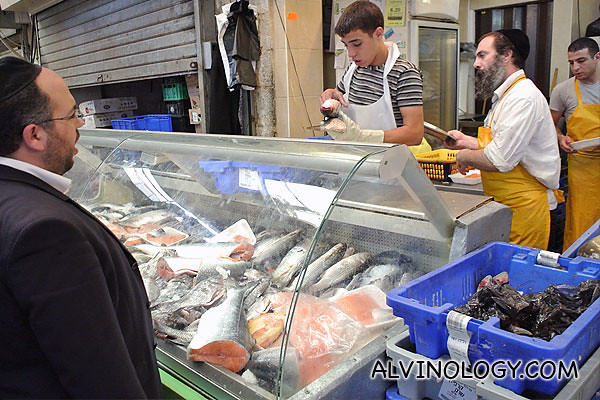 An ultra-orthodox man buying fish