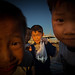 Kids showing the catch of the day in Wonsan, North Korea by Benoit Cappronnier