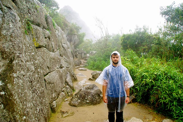 josh in the rain at machu picchu