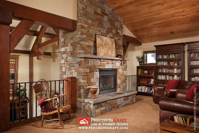 Loft Library | Custom Timber Frame Home | PrecisionCraft timber Frame Homes