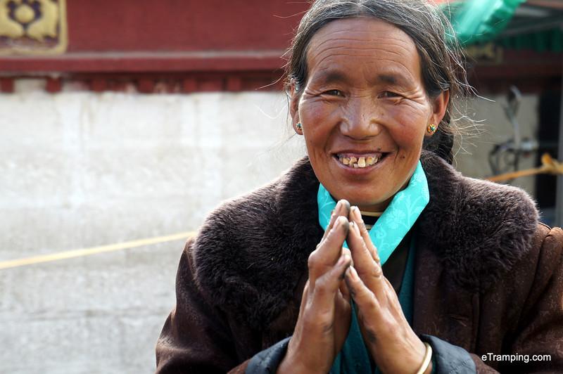 Tibetan lady smiling during prayers