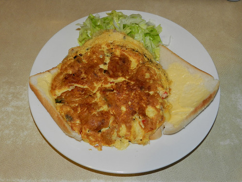 White bread, white pudding, lettuce.. Omelette with scallions, mushrooms, red pepper and mild white cheddar..