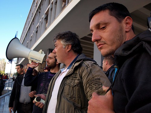 Protesting Greek university employees speak to supporters after court case adjourned. by Teacher Dude's BBQ