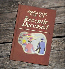"sketchbook with cover reading ""Handbook for the Recently Deceased"""