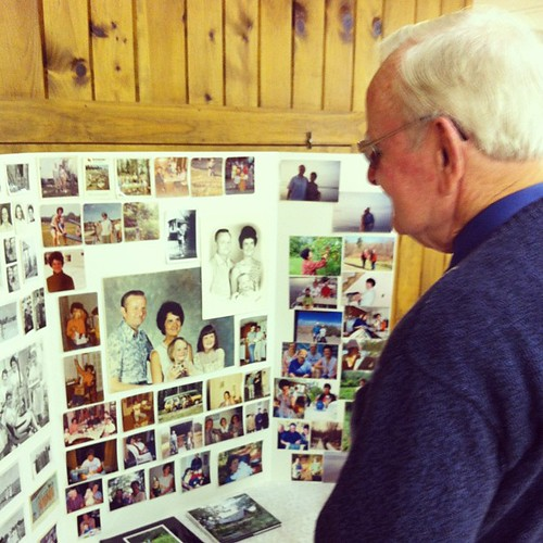 Dad and the photo board at Mom's memorial service