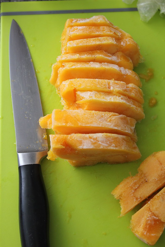 Chopped chunks of frozen mango gelato