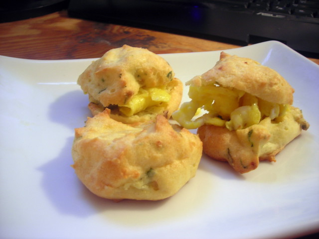 "Scrambled egg ""mini-sandwiches"" -- shallot-herb gougères, scrambled eggs, capers"