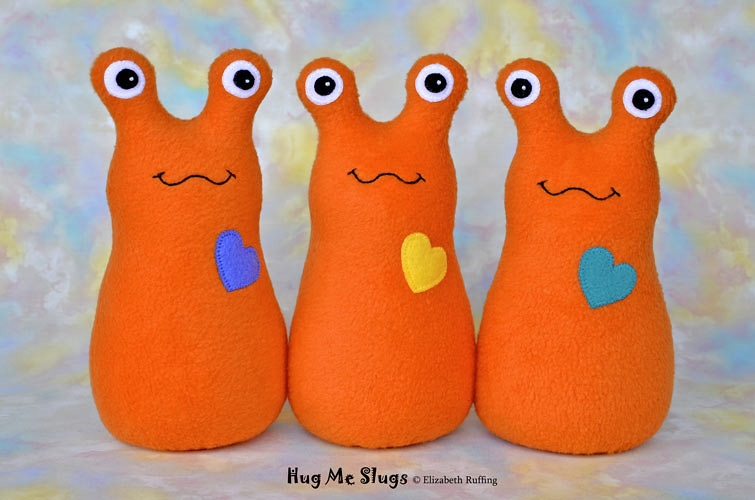Slugterra and orange fleece Hug Me Slugs, original stuffed animal art toy by Elizabeth Ruffing