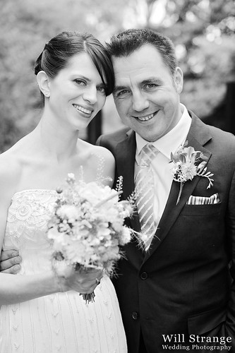 Bride and groom pose as newlyweds