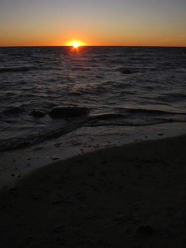 light sunset sun lake water michigan lakemichigan goodhart