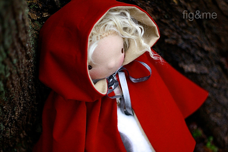 A scarlet red hooded cape