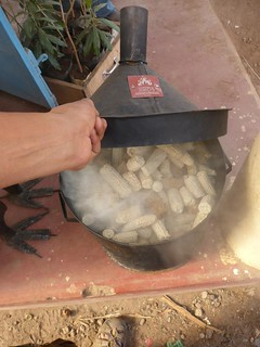 mini kiln filled with maize cobs in action