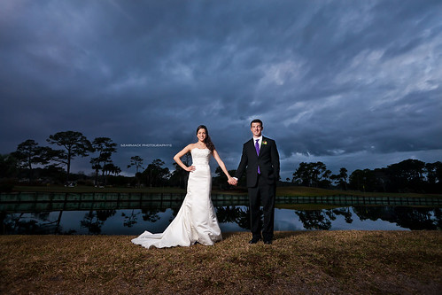 wedding sunset storm reflection clouds golf groom bride couple skies dramatic course strobist