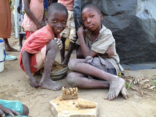 Village boys with their little toy