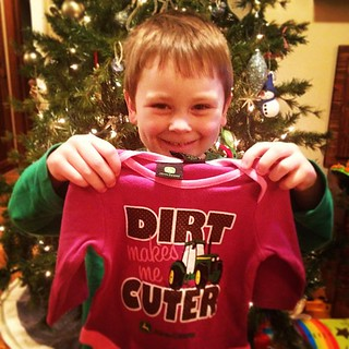 Oh that smile makes me happy! Isaac so excitedly picked out a present for his new baby sister. #begrudinglypink #johndeere #itsagirl #proudbrother