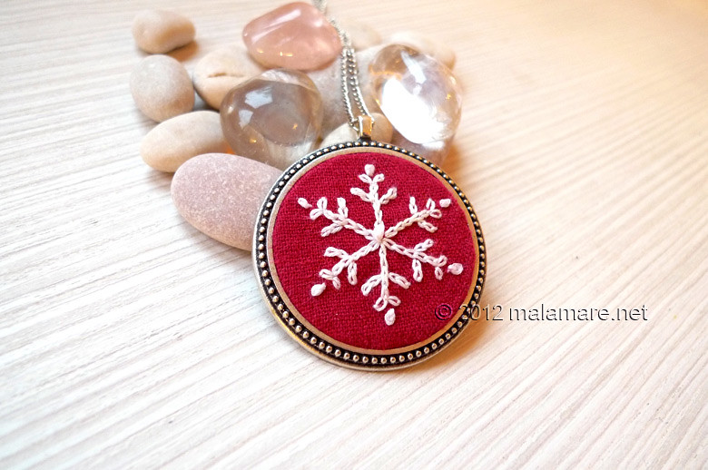 hand embroidered snowflake pendant