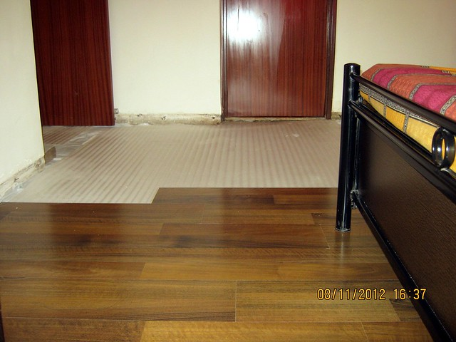 Pathetic condition of the wooden flooring in Nalini & Swapnil's bedroom at Sangria, Megapolis, Hinjewadi Phase 3, Pune - 1