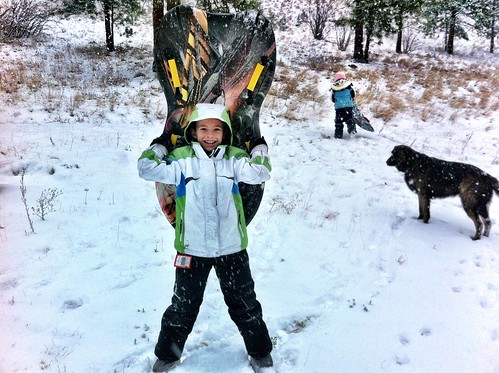 It's coming down pretty hard, so the kids busted out the gear. It turns out it IS a sledding day.