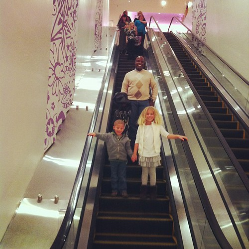 He's figuring out escalators. She's helping.