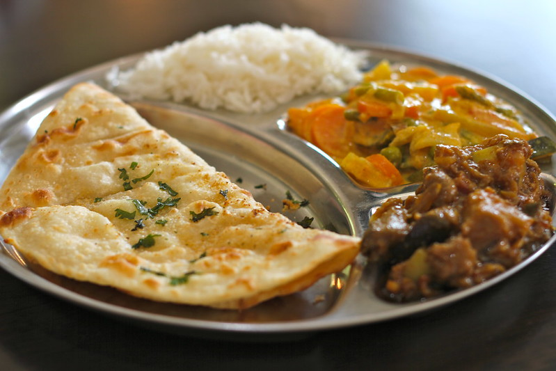 Two curries with rice and naan
