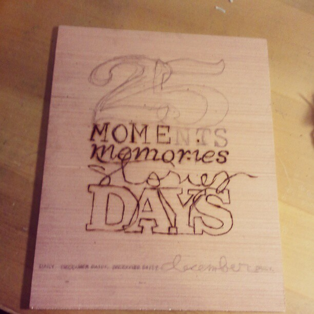 Working on wood burning the cover for my #decdaily using word art by @aliedwards
