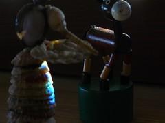 joli flou sur la poupée, mais le reflet sur le dos de l'âne m'échappe toujours
