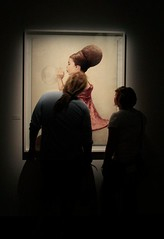 Picture of two people looking at a painting