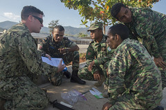 In this file photo, Master-at-Arms 2nd Class Carson Jones reviews evidence collection procedures with Forsa Defesa Timor-Leste service members in August 2016. (U.S. Navy/MCC Lowell Whitman)