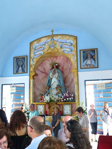 Romeria in Pruna: effigy of Mary dressed as a shepherdess in church