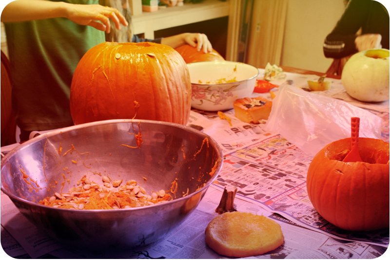 {carving pumpkins} at the table