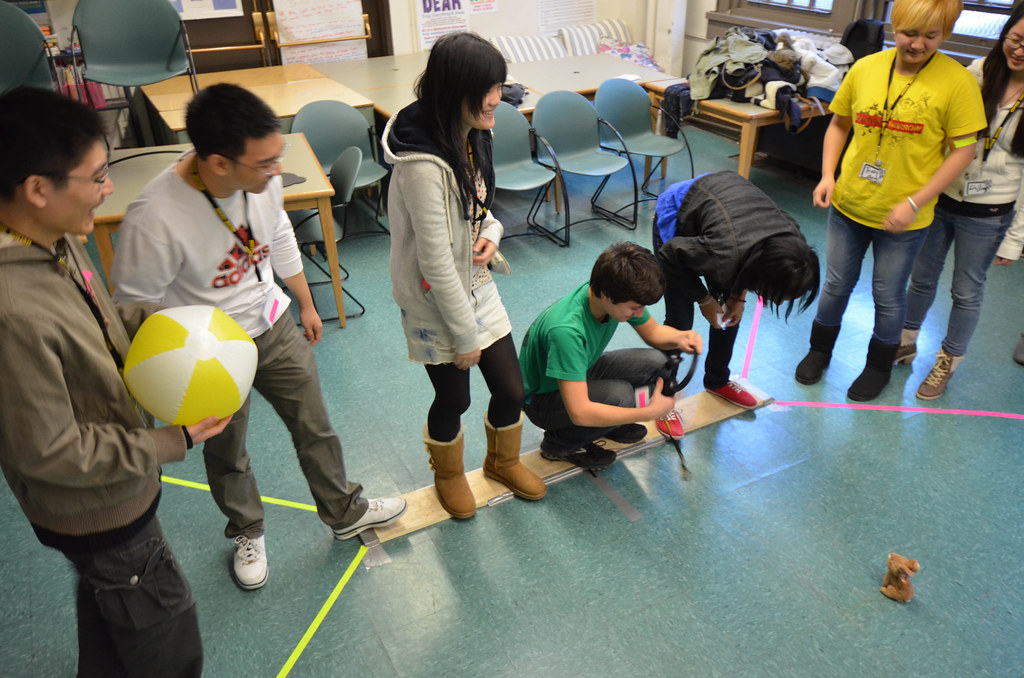 An image of learners running the obstacle course