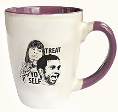 "white mug with illo of Donna and Tom and the words ""Treat Yo Self."""