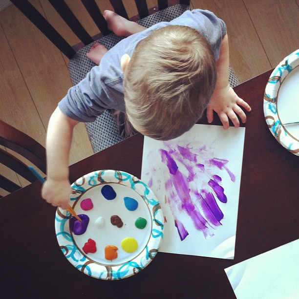 The boy loves to paint
