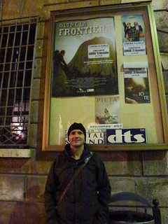 Giuseppe in front of the Oltre La Frontiera poster.