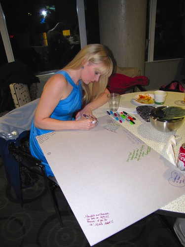 signing the poster