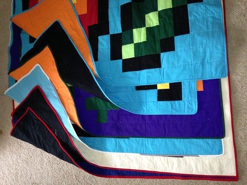 6 quilts ready to be shipped to family for Christmas